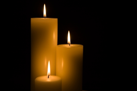 A trio of candles cutting through the darkness