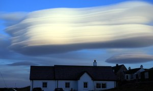 Alamy Live News. D4EYH0 Isle of mull, Scotland, UK. 12th March 2013. Lenticular Clouds, Altocumulus lenticularis, over the village of Fionnphort on the Isle of Mull in the Inner Hebrides of Scotland © PictureScotland / Alamy Live News This is an Alamy Live News image and may not be part of your current Alamy deal . If you are unsure, please contact our sales team to check.